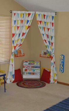 Make a reading corner in kids playroom by just hanging curved shower rod with some shelves, pillows, and a rug. Deco Kids, Home Daycare, Daycare Setup, Daycare Ideas, Shower Rod, Toy Rooms, Kids Rooms, Children Playroom, Room Kids