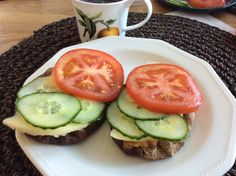 Karjalan piirakka with thin slice of cheese and tomato and cucumber . Have this every morning for breakfast , so lovely!