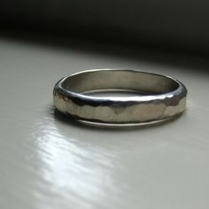 Mens Wedding Ring of Hammered Sterling Silver (Etsy / tinahdee)