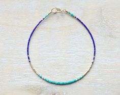 This is a very thin bracelet (the beads are just 1mm!) with lots of color and sparkle. It is composed of blue turquoise bicone beads and lapis lazuli and