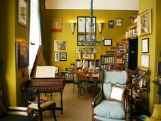 Fabulous colour on the walls. Busy eclectic room filled with collectable items
