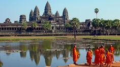 Buddhist monks in front of the reflection pool at Angkor Wat, Cambodia