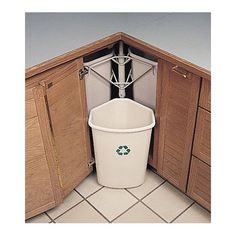 Rotary in-cabinet recycling bins. I need this! The countertop is no longer an option.