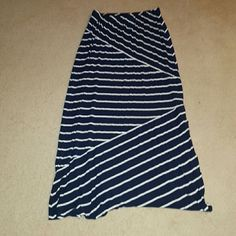 Loft Navy and White Maxi Skirt Maxi Skirt from Loft, navy and white. Elastic waist band. Has a split on one side that comes up to the knee. The stripes are very flattering since there is a mix of horizon and diagonal stripes. 91% rayon and 9% spandex. LOFT Skirts Maxi