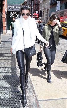 Kendall dons her favorite leather pants, a white fur vest and aviator sunglasses while out and about in NYC with her sister.