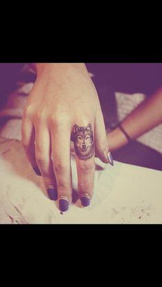 Wolf tattoo on finger. Love!!