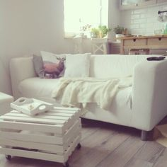 white Ikea Klippan sofa + crate table
