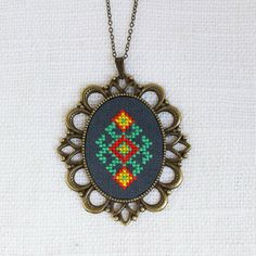 If you love ethnic pieces and unique jewelry, you'll adore this stylish Ethnic hand-embroidered necklace. With a special vintage look, it becomes a wonderful addition to your everyday outfit. Cluster Necklace, Teardrop Necklace, Moon Necklace, Floral Necklace, Folk Embroidery, Cross Stitch Embroidery, Bordado Popular, Mini Cross Stitch, Look Vintage