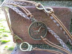 """This+is+a+very+unique+bracelet.+Steam+punk+style.+Brown+and+tan+leather+feature+bronze+handcuff+charms+that+have+the+word+""""freedom""""+on+them.+The+false+watch+face+can+imply+a+number+of+things...+Freedom+from+the+restraint+of+time,+freedom+to+do+whatever+you+choose+with+your+time,+or+that+you+desir..."""