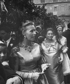 Pimpinela wearing her tiara as a necklace.