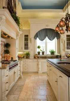 I like just about everything here: the cabinets, tile, window, but would change out the blue to a nice neutral or golden tone....