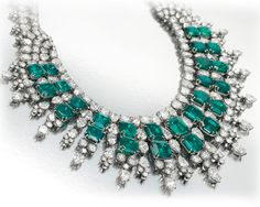Emerald and Diamond Necklace, by Harry Winston. Designed as a graduated double row of rectangular-cut emeralds, extending a pear and circular-cut diamond fringe, joined by circular and pear-shaped diamond clusters to the circular-cut diamond double row backchain, mounted in platinum, 1955