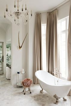 HGTV invites you to see this sophisticated bathroom with a soft, neutral color palette and charming clawfoot tub. Bad Inspiration, Bathroom Inspiration, Bathroom Ideas, Bathtub Ideas, Bathroom Photos, Home Interior, Interior Design, Velvet Curtains, Beige Curtains