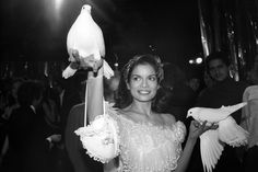 An ethereal Bianca Jagger, with avian accessories, Studio 54, 1977.