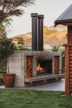 Oven Inspiration, Fireplace Gallery, Chimney Cap, Custom Fireplace, Through The Roof, Stone Cladding, Outdoor Fireplaces, Corten Steel, Polished Concrete
