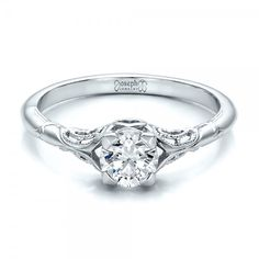 #100700 It's not hard to see the appeal of antique engagement rings. The romance of vintage designs sets a good mood for any proposal, and the classic...