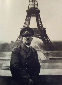 Hitler poses at the Eiffel Tower in Paris after the invasion and occupation of France.