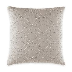 Add chic sophistication to your bed with the urbane Catherine Malandrino Metro Adrian Square Throw Pillow. With oversized scallop beading on slub fabric, the stylish throw pillow is the perfect layering piece to the cool, contemporary bedding.