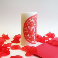 Adapted from a beautiful Chinese paper cut, this Double Happiness design makes the perfect wedding gift for a special couple for whom you wish a lifetime of joy, or would make a lovely wedding decoration. This 6 high, white, unscented pillar candle is a commercially produced paraffin wax candle, which I decorate by hand here in my workshop in Portland, Maine. I carefully select my favorite vintage images and use a heat transfer process to bind an image onto the candle. It is not a sticker…