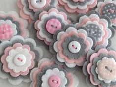 ***BABY GIRL GREY*** Set of 3 Handmade felt & button embellishments   Embellishments in this listing are made with quality felt in Baby Pink, Silver Grey & White and centered with the hand stitched button.  Each pack contains x3 gorgeous felt flowers chosen at random by me.   These are perfect for brooches, clippies, embellishments, hair pieces, bunting, card making, scrapbooking uses are really endless...  ***Please note: The flowers you receive may be not exactly as pictured, but they…