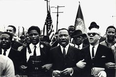 Leaders: Martin Luther King Jr (center), James Forman (left)  and Reverend Jessie Douglas (right) are pictured above marching around the state capitol in Montgomery, Alabama