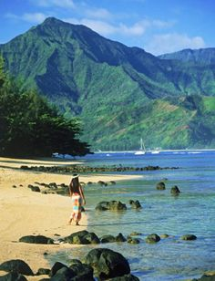 Woman walking on the beach at Hanalei Bay on Island of Kauai, Hawaii