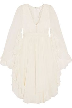 EXCLUSIVE AT NET-A-PORTER.COM. Chloé's 'Pacha' collection evokes the free spirit of Ibiza in the '70s. This dress is cut from swathes of weightless silk-crepon, complete with cascading silk ruffles and crocheted lace panels at the yoke and waist to define the billowy shape. Wear yours on balmy summer evenings with sandals.