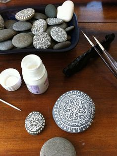 brought some beautiful round pebbles from the beach at Kaikoura to paint with white ink