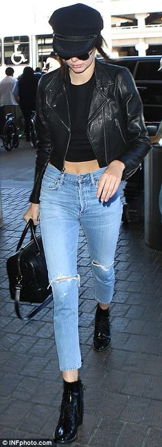 Jet style traveler: The 20-year-old showed off a hint of her flat midriff at LAX as she made her way inside to catch a flight out of Los Angeles