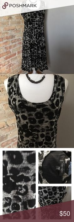 Karen Kane high low dress leopard 1X Karen Kane black and white leopard print high low dress in 1X. Stretchy fabric and lining. Worn a couple of times and is in very good condition. Bust is 20 inches lying flat. 39 inches long from top of shoulder to hem in the back. Smoke free pet friendly home. Karen Kane Dresses High Low