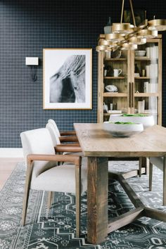 The darker shades, wood tones and brass work so well together in this dining room design. A great shot of Mountain Modern project. Table And Chairs, Dining Chairs, Dining Table, Dining Rooms, Magnolia Journal, Home Design Magazines, Mountain Modern, Exposed Wood, Dining Room Design