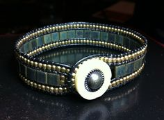 Leather wrap cuff bracelet, triple row beaded bracelet, gold metal and green iris tila beads. $35.00, via Etsy.