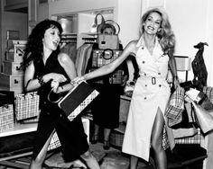 Fashion icons Marie Helvin and Jerry Hall, vintage Burberry, 1970's (and the lady holding the boxes)