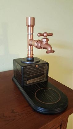 Copper and stained wood liquor dispenser. Perfect for the home bar or man cave. They are made from stained wood and copper pipe. They hold a standard 750 ml bottle if your favorite alcoholic beverage. They use a brass tap. Liquor Bottle Crafts, Diy Bottle, Liquor Bottles, Bottle Holders, Whiskey Dispenser, Alcohol Dispenser, Pipe Furniture, Wine Rack, Alcoholic Drinks