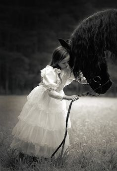 Don't worry my brave steed, you won't remain a horse forever. When I grow up, I shall blow you a magic kiss that will turn you into a prince, and we shall run through the grass and live happily ever after...