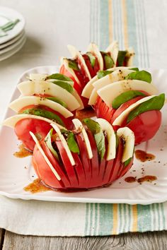Hasselback Caprese Tomatoes – Mix up your caprese salad recipe with these Hasselback Caprese Tomatoes. Tomatoes, mozzarella cheese, basil -- what more could you ask for?