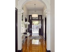Love the door, high gloss floor with hide rug, mirrored console, black door frames and base, pendant with drum shade Black Front Doors, Australian Homes, Timber Flooring, House Entrance, Entry Hall, White Walls, Colorful Interiors, Foyer, Entryway