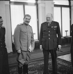 Winston Churchill shares a joke with Marshal Stalin (with the help of Pavlov, Stalin's interpreter, just visible left) in the conference room at Livadia Palace during the Yalta Conference.