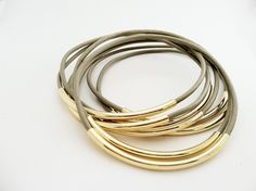Taupe Leather Bangles with Gold or Silver Tubes. $23.00, via Etsy. - These come in so many different colors!