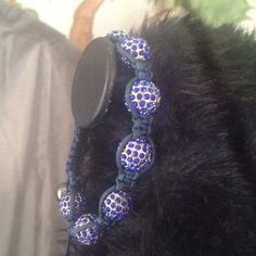 Shambhala Bracelet in cobalt blue Encrusted with cobalt blue crystals on adjustable black string Accessories