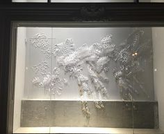 Lit up at night I am super excited to share my windows installed in Nordstrom Rack in collaboration with @sfmoma. All handcut paper with an @xactobrand knife and gold paint.  This right window stands at about 17' tall and 12' wide by giannapapercutting
