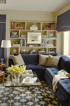 Elegant looks in small living room spaces are simple when you combine plain colors with a unique patterned piece.