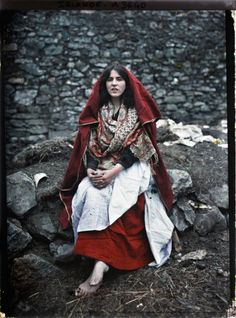Main Ní Tuathail, a 14 year old girl from the Claddagh wearing traditional Claddagh dress. Galway, Ireland, May 1913. One of the first color photographs taken in Ireland.  This is the work of two French women, Marguerite Mespoulet and Madeleine Mignon-Alba, who used newly available autochrome color plates.