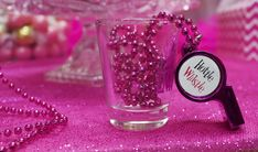 DIY Bachelorette party favor idea to put these hottie whistles in a shot glass for each