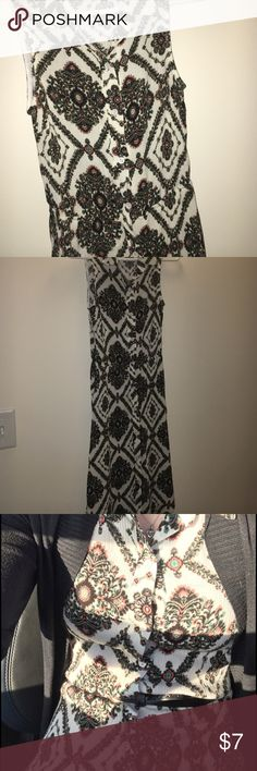 Button down, sleeveless, midi dress Beautiful printed, button up, midi dress. White background with olive and coral print. Crepe like material. Looks perfect with a skinny black belt! Size small, used, good condition. Just one button hole that needs tightening! Charlotte Russe Dresses Midi