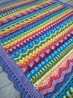Tooty Stripey Blanket is a beautiful combination of stitches, colors and amazing talent of the author of a crochet pattern. As a result, we have a baby blanket, which we can easily enlarge to the normal size of an adult blanket.