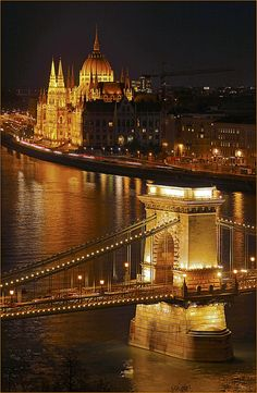 Goldene Donau  view from Buda Castle accross the River Danube and the Széchenyi Chain Bridge to the Hungarian Parliament