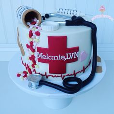 Nurse cake, buttercream, fondant, syringe, pills, pill bottle, stethoscope, LVN, RN
