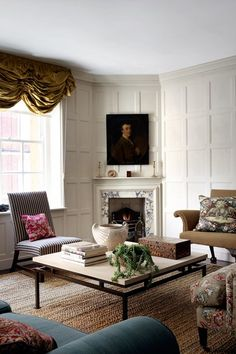 Small Panelled Sitting Room With Antiques, white living room with sixteenth-century style wall panelling and corner chimneypiece - design ideas for small spaces.