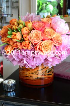 Apricot/pink roses and tulips, pink hydrangea and peonies.